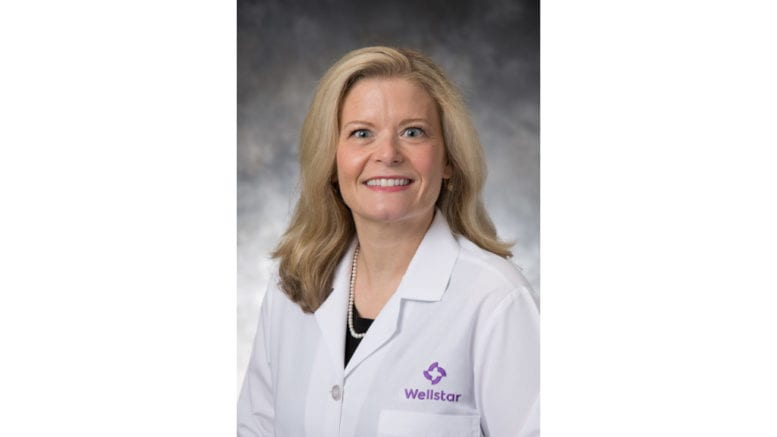 Dr. Laura Pearson in white Wellstar lab coat