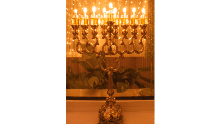 A photograph of a Menora, a nine-candle holder