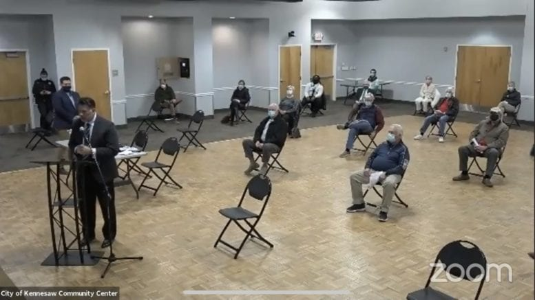 Due to social distancing protocols, overflow audience members attended the public hearing for the Lockhart Drive rezoning via Zoom from the Ben Robertson Community Center. (Asst. City Manager Marty Hughes at the microphone).