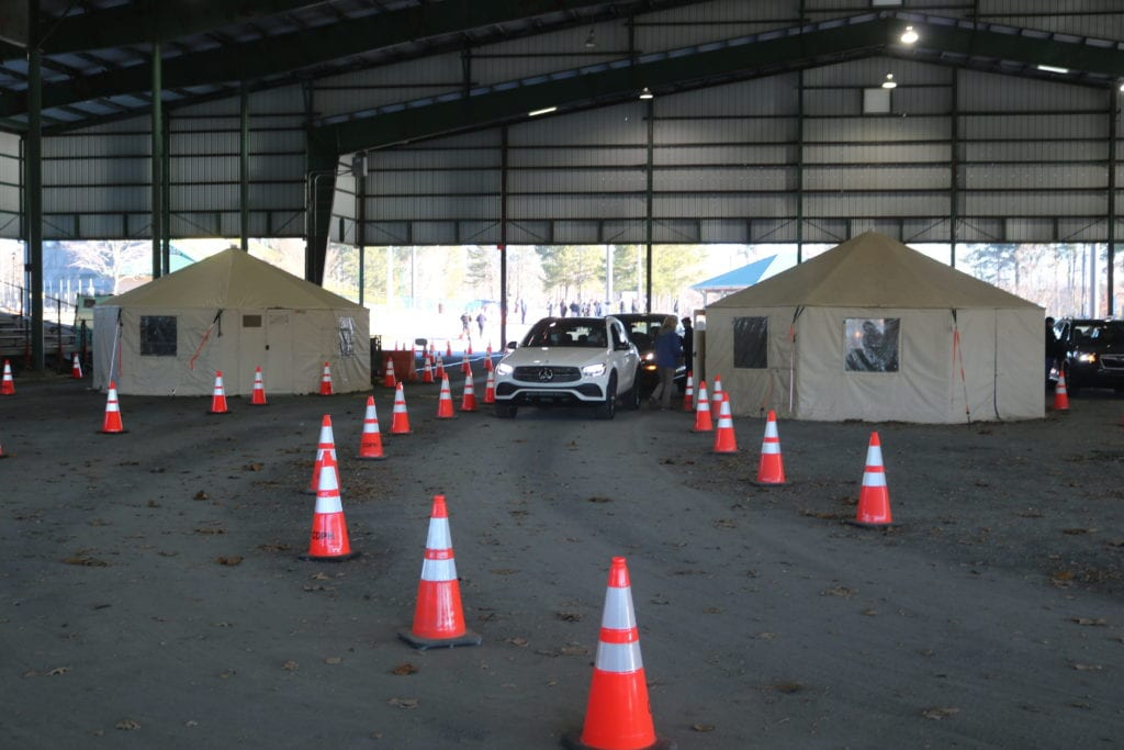 cars lined up at vaccination site