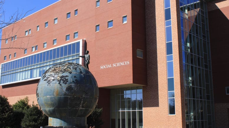 KSU social science building with globe sculpture