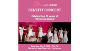 Divas with a Cause promo image for benefit concert -- seven female vocalists in white dresses singing onstage