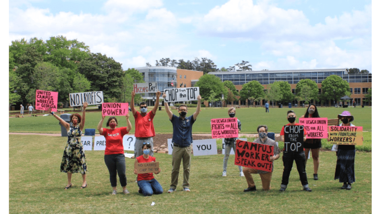 Union members hold up signs at KSU