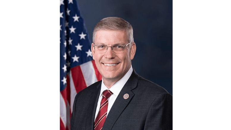 headshot of Representative Barry Loudermilk with flag behind his right shoulder