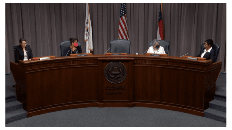 Cobb Commissioners at the podium. Lisa Cupid absent.