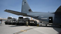 U.S Air Force personnel load a Rapid Dragon pallet onto an EC-130SJ aircraft ahead of an airdrop.