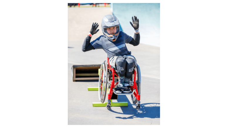 Young athlete in wheelchair in competition