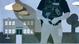Image of police officer in front of school building