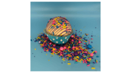 Photo of cupcake and loose sprinkles